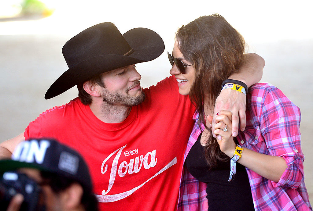 Ashton Kutcher (L) and Mila Kunis attend day 1 of 2014 Stagecoach: California's Country Music Festival