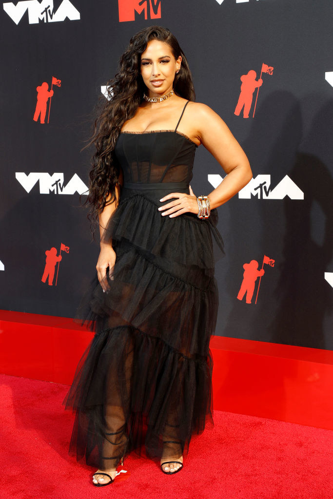 Nessa on the red carpet in a frilly lace black gown