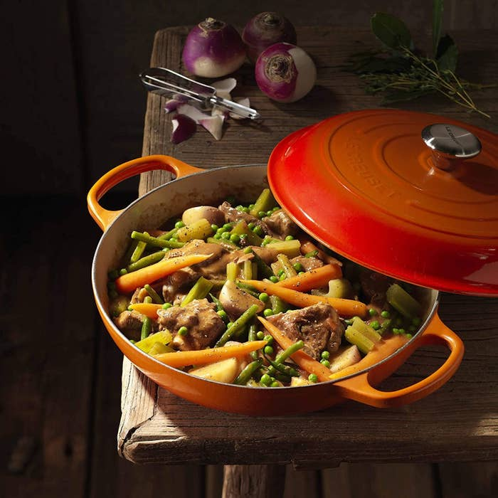 the pan in ombre orange with beef, potatoes, carrots, and peas