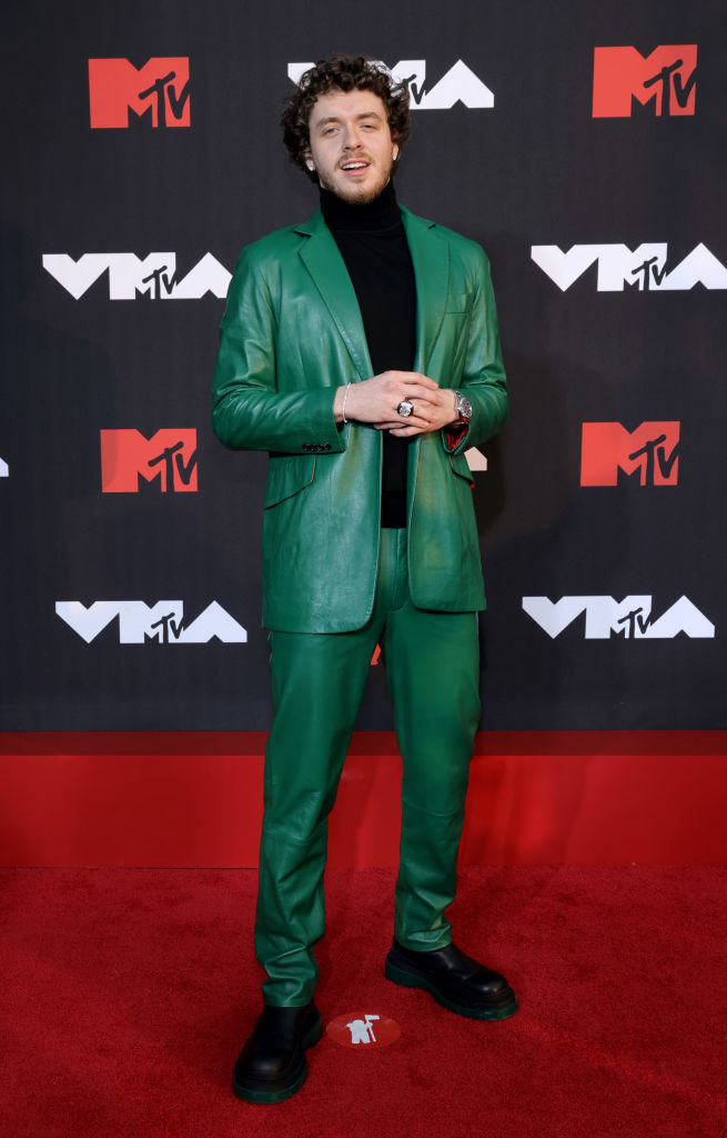 Jack Harlow in a green suit and black turtleneck