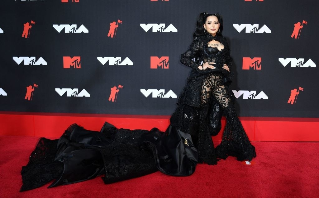 Bella Poarch on the red carpet in an epically long black lace gown
