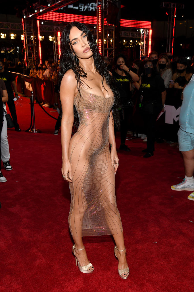 Megan Fox on the red carpet in a completely sheer gown