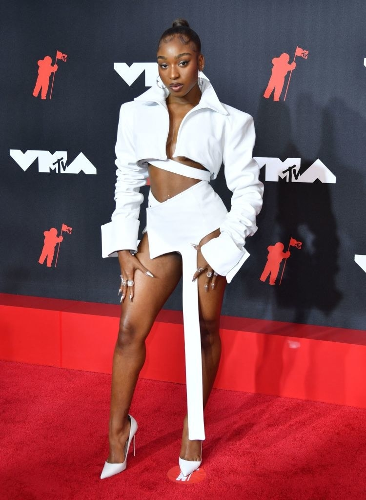 Normani on the red carpet in an all white jacket and mini skirt