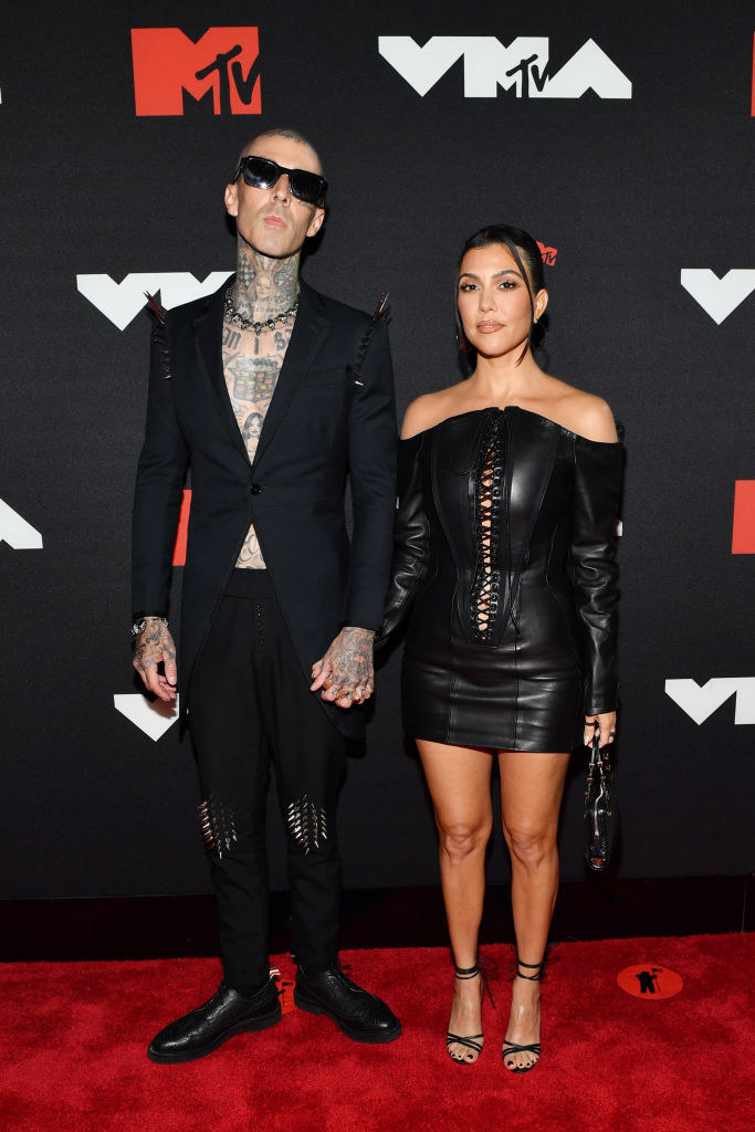 Travis Barker and Kourtney Kardashian on the red carpet in matching black outfits