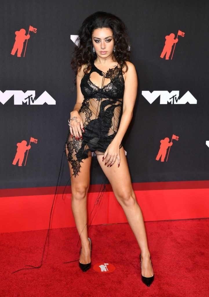 Charli XCX on the red carpet in a sheer mini dress