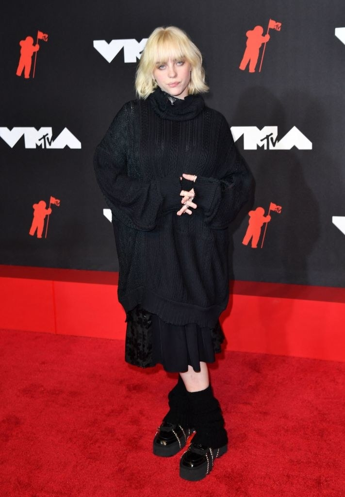 Billie Eilish on the red carpet in an all black baggy ensemble