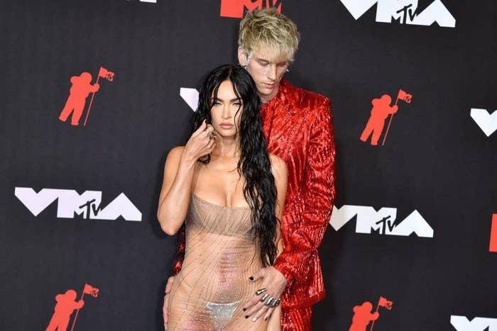 Megan Fox (L) and Us singer Machine Gun Kelly arrive for the 2021 MTV Video Music Awards