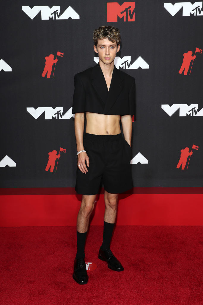Troye Sivan in a black crop top and shorts