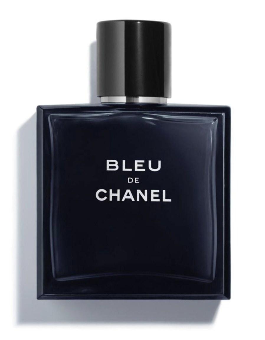 "The deep blackish blue square bottle says ""BLEU DE CHANEL"" and has a black and chrome lid"