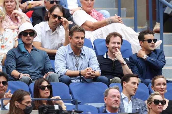 Rami Malek sitting in the same row as Brad and Bradley