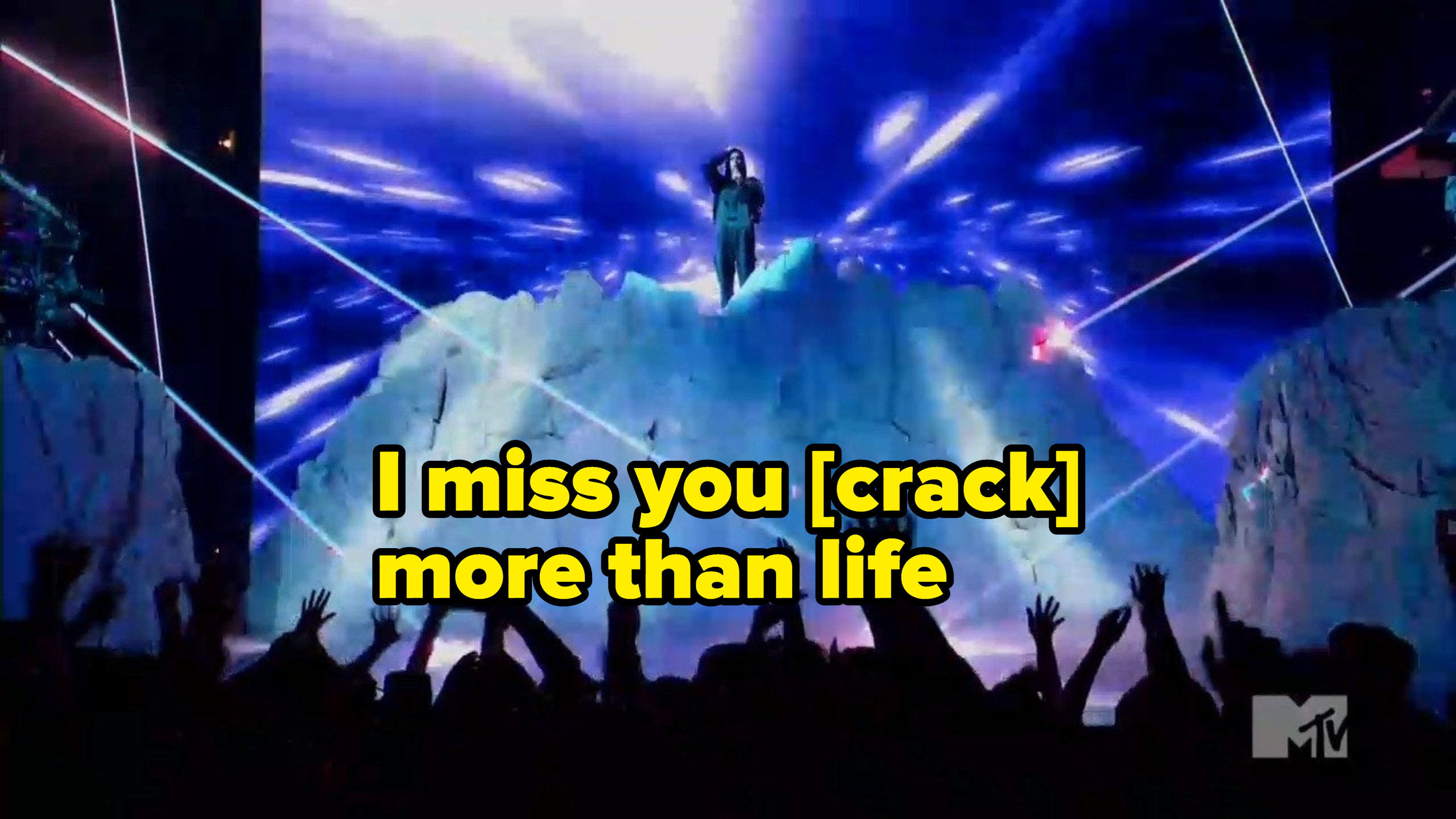 """Justin on stage with the caption """"I miss you [crack] more than life"""""""