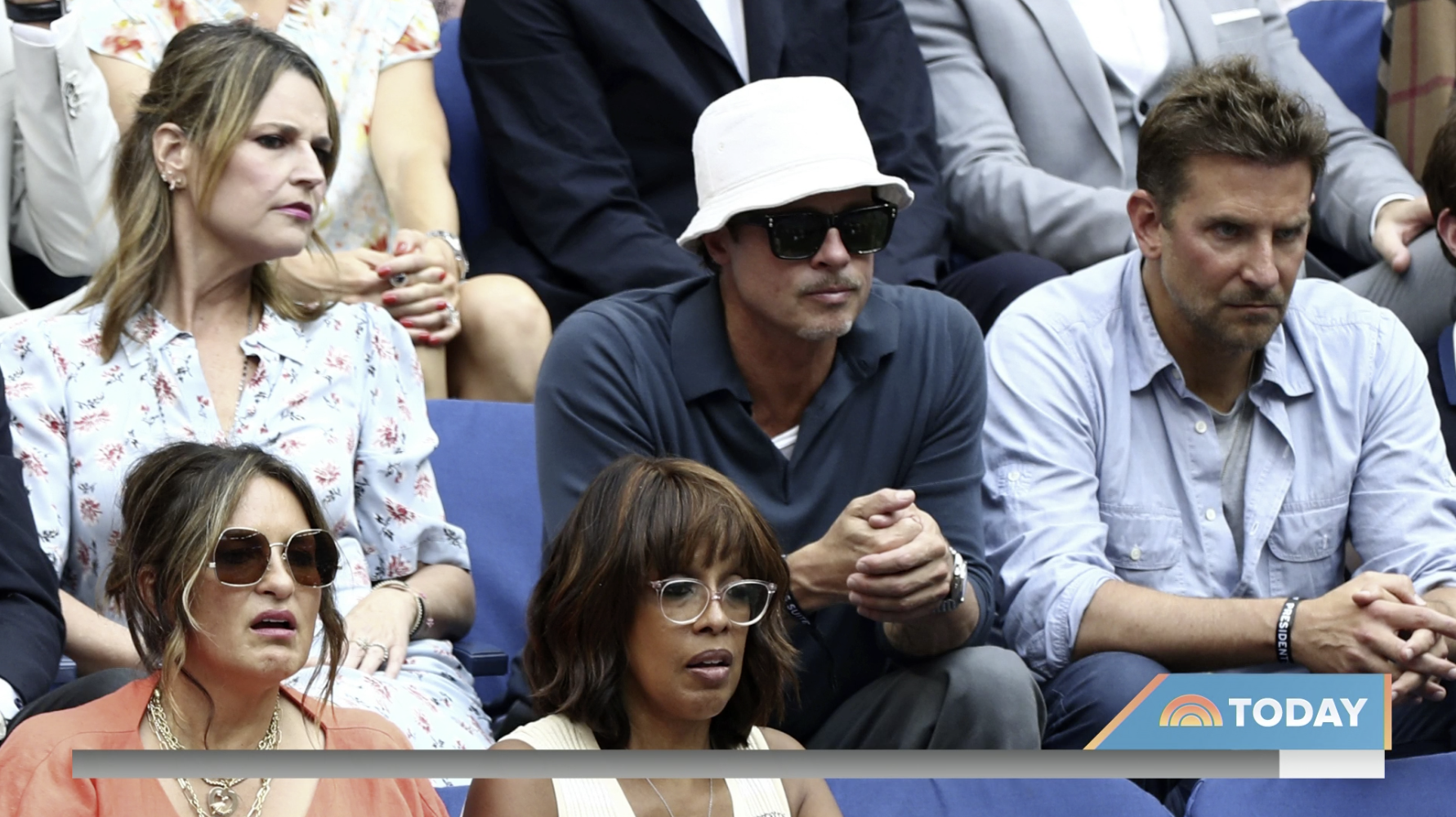 Close-up of Savannah sitting next to Brad with Gayle and Mariska one row down