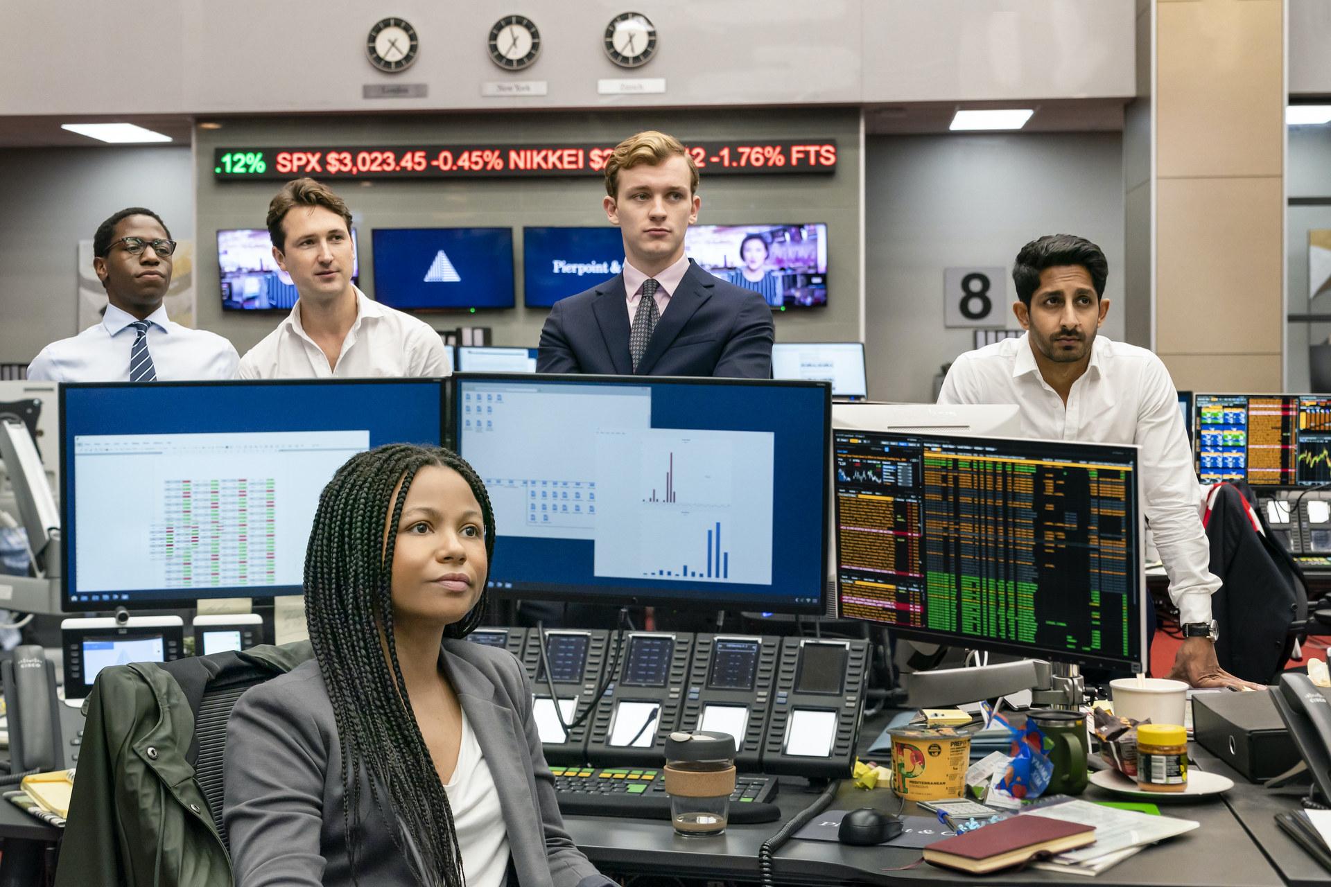 David Jonsson, Ben Lloyd-Hughes, Harry Lawtey, Sagar Radia, and Myha'la Herrold huddle together in their investing office