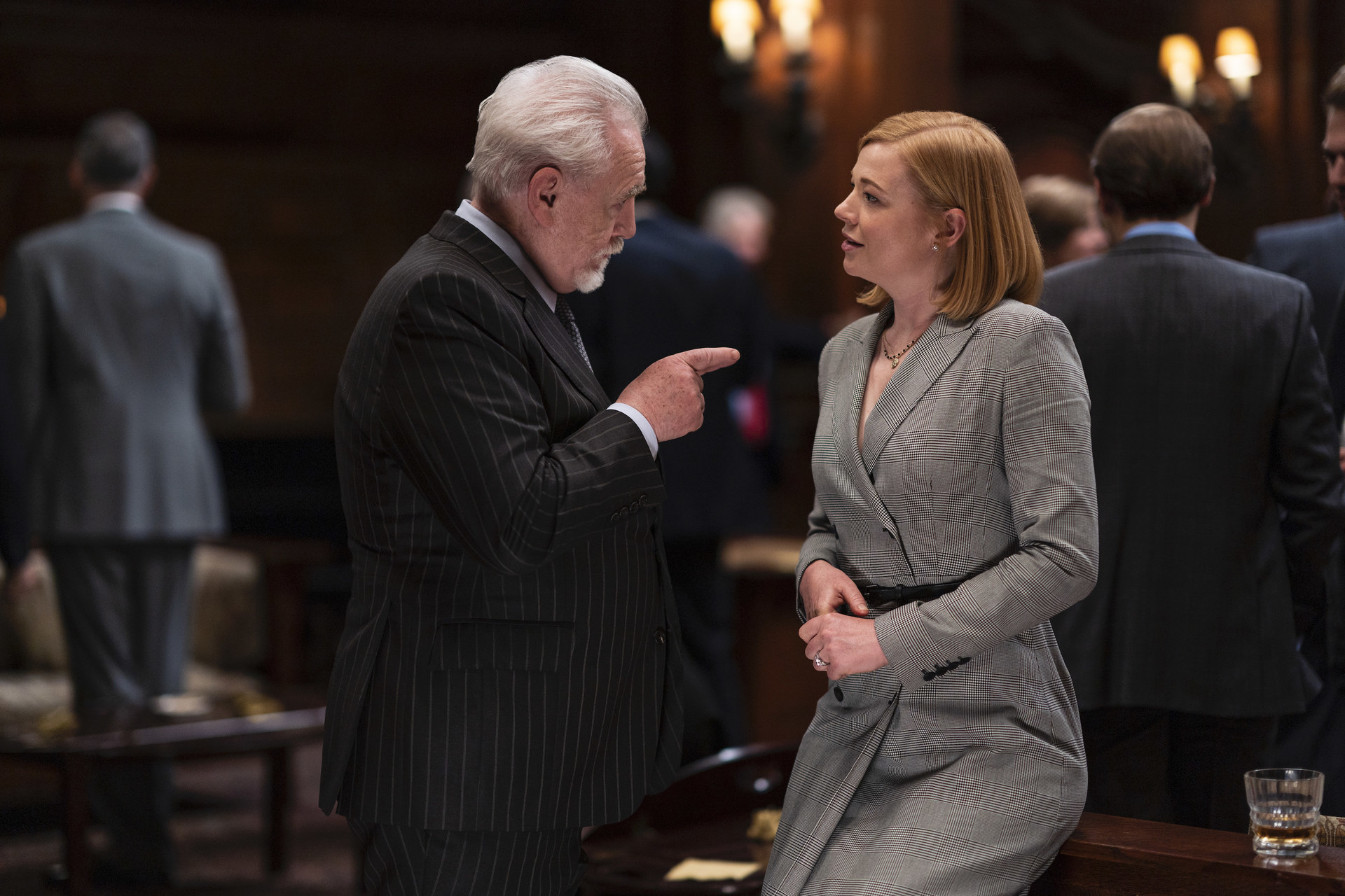 Brian Cox speaks to Sarah Snook at a business function