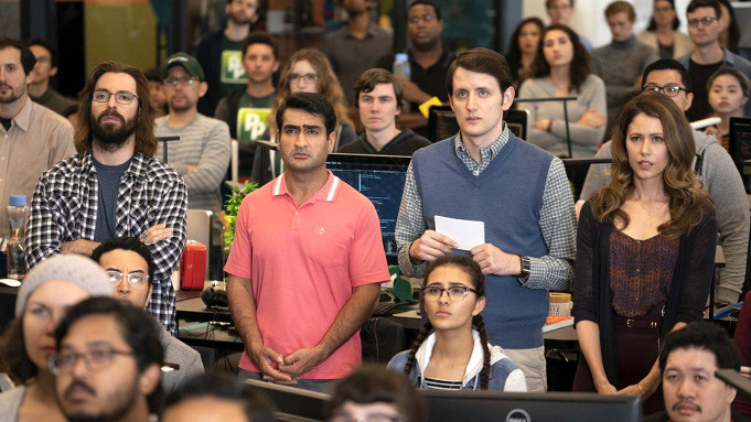 Martin Starr, Kumail Nanjiani, Zach Woods, and Amanda Crew stand in a crowd watching something