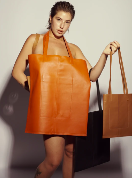 A model carrying the tote bags in every color and size available