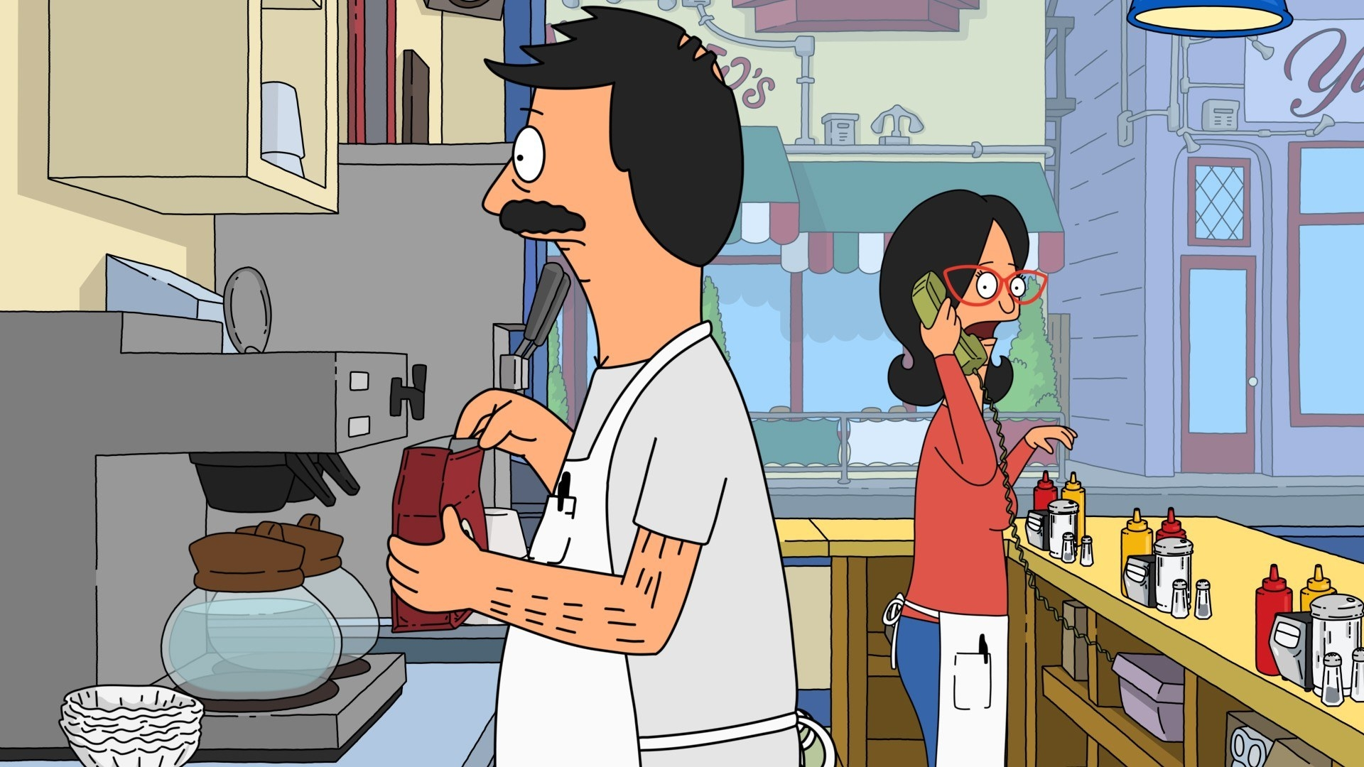 Bob and Linda Belcher stand behind the counter in their diner