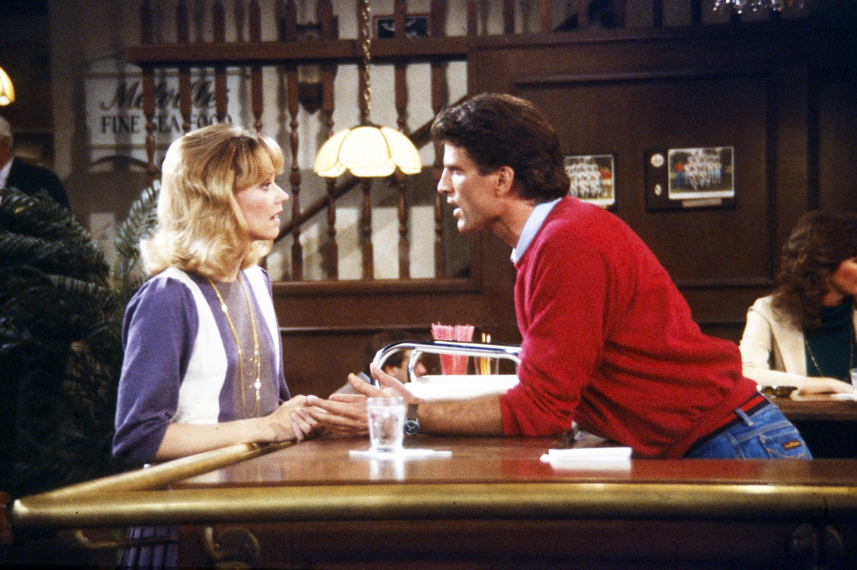 Shelley Long and Ted Danson talk across the bar