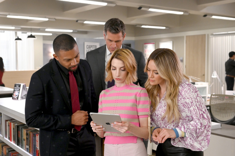 Charles Michael Davis, Peter Hermann, Molly Bernard, and Hilary Duff gather around a tablet