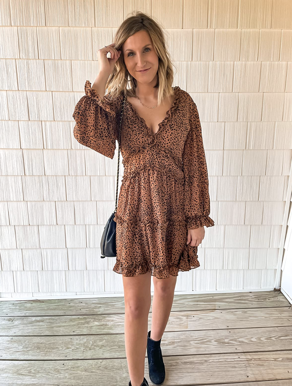 reviewer wearing the leopard dress
