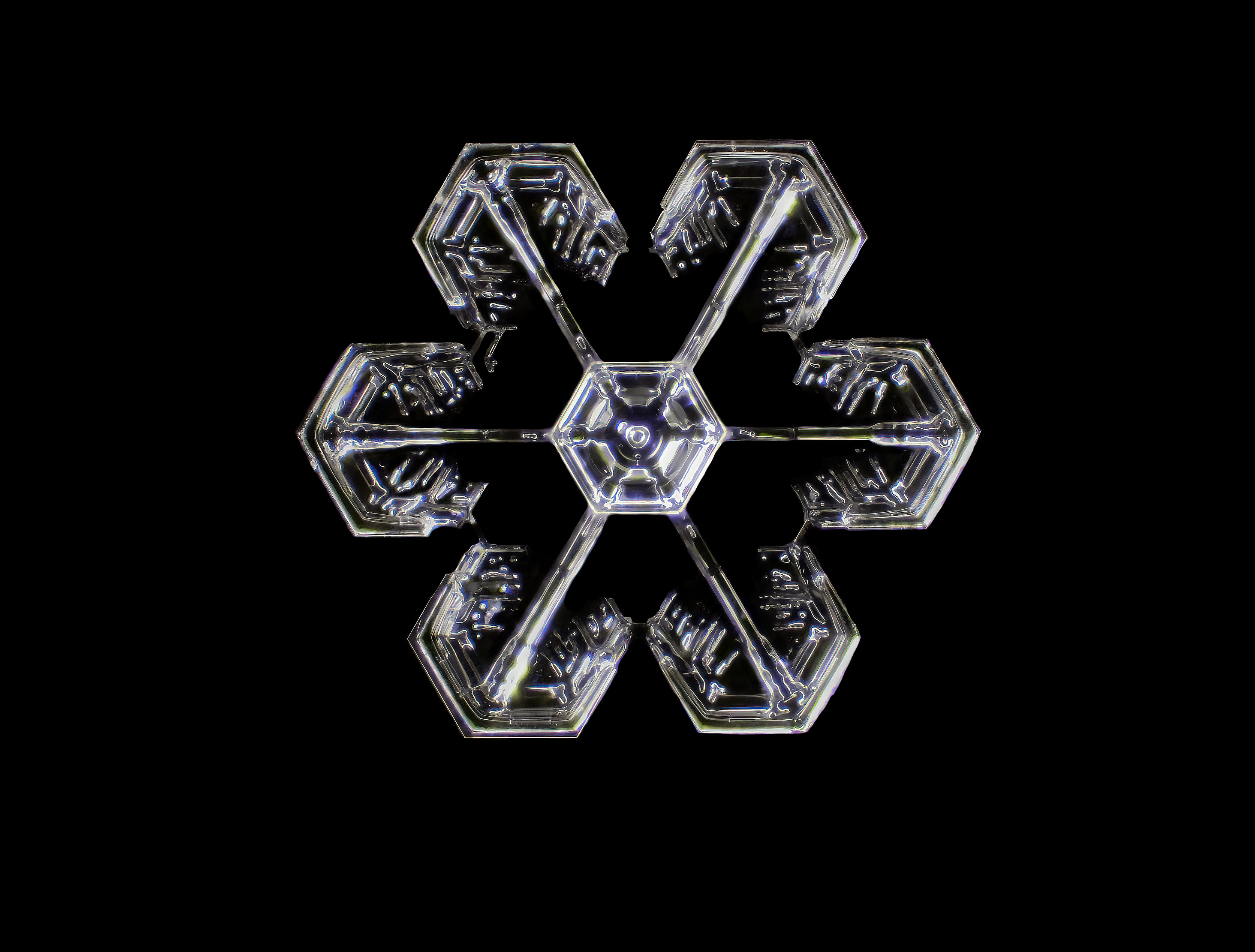 A snowflake on a black background, magnified many times