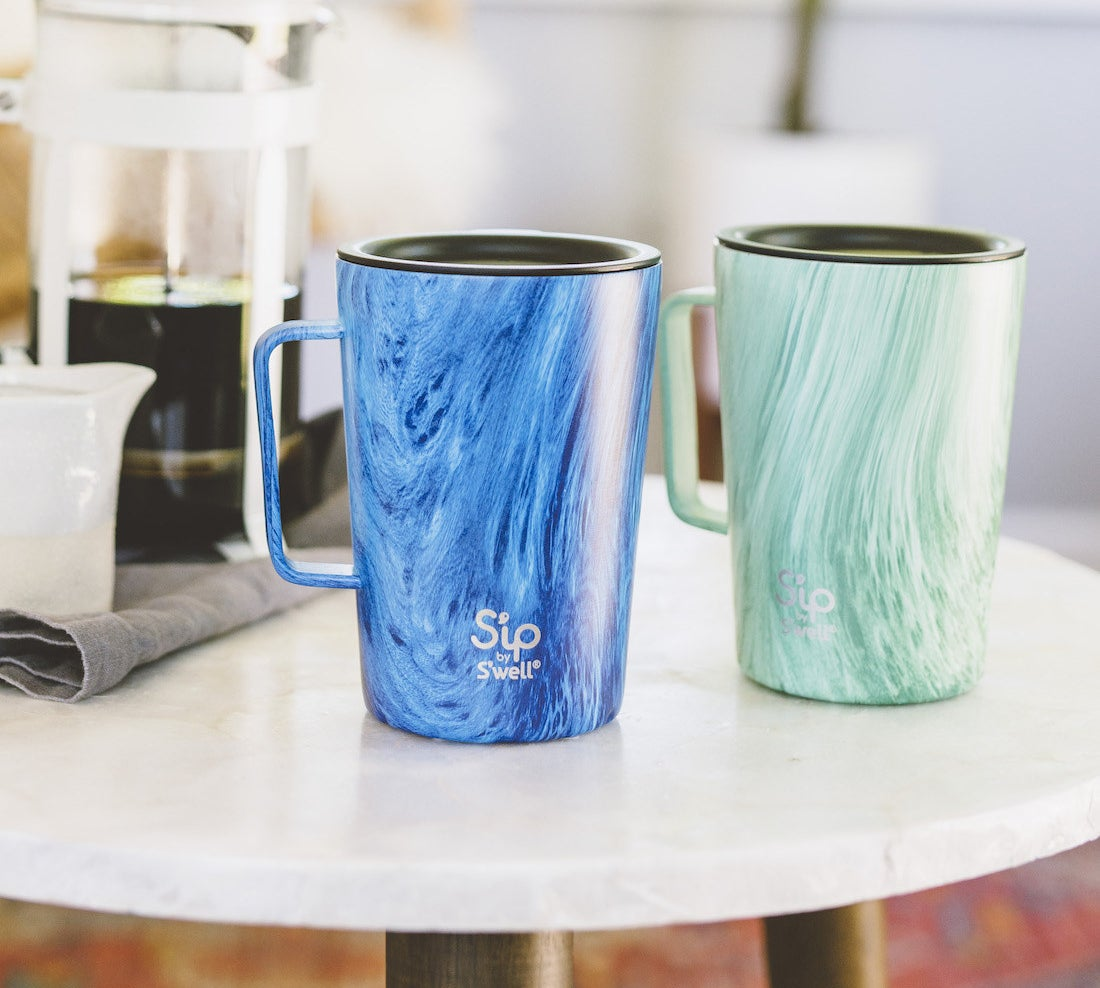The green and blue travel mugs with handles