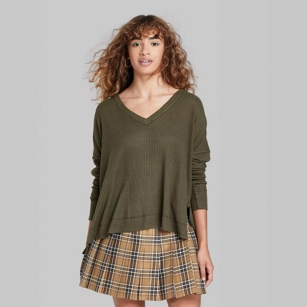 Model wearing forest green sweater