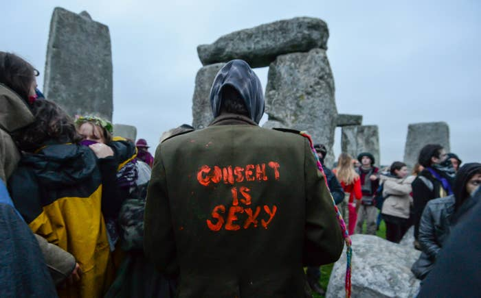 """An image of the back of someone's jacket with """"Consent is sexy"""" painted on it in red paint"""