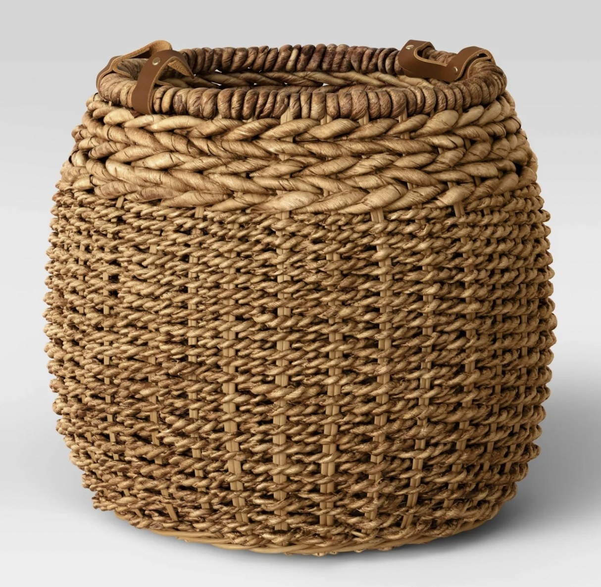 a wicker basket with leather handles