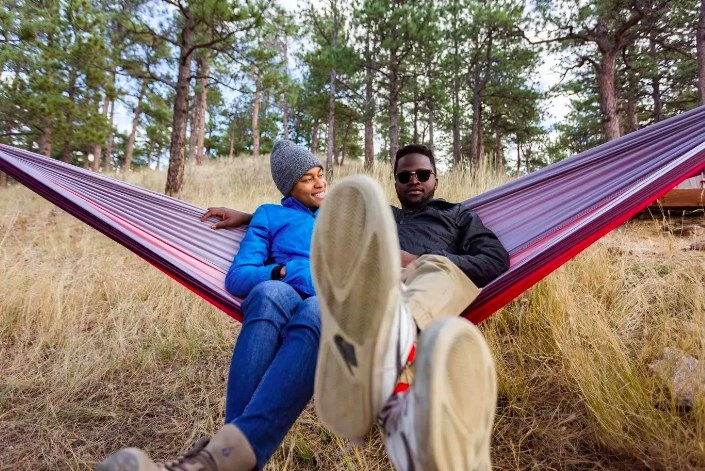Two people relaxing in the hammock