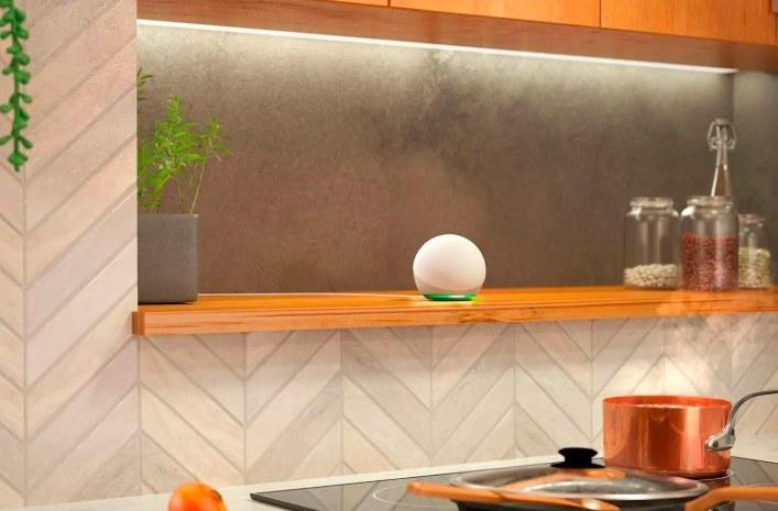 The white echo dot sitting on a kitchen counter