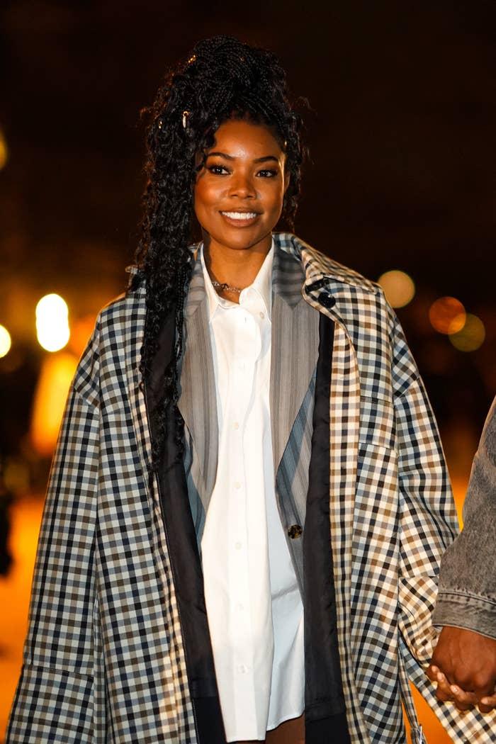 Gabrielle rocking a plaid jacket and dress shirt