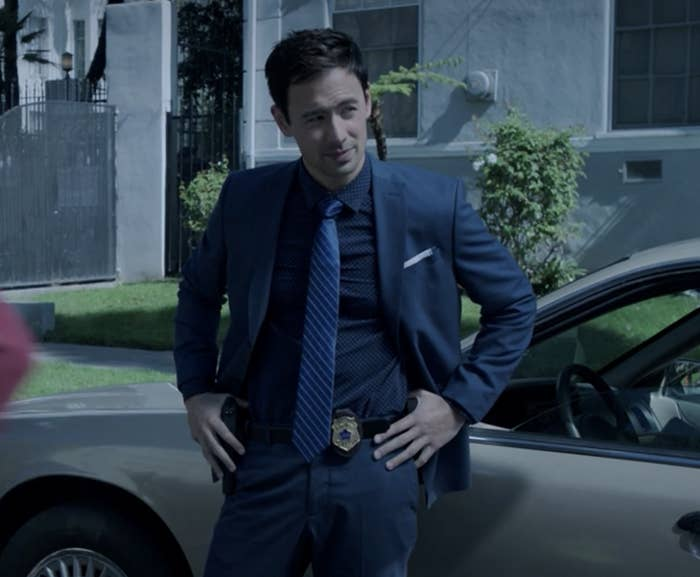 Detective Kekoa standing next to a car