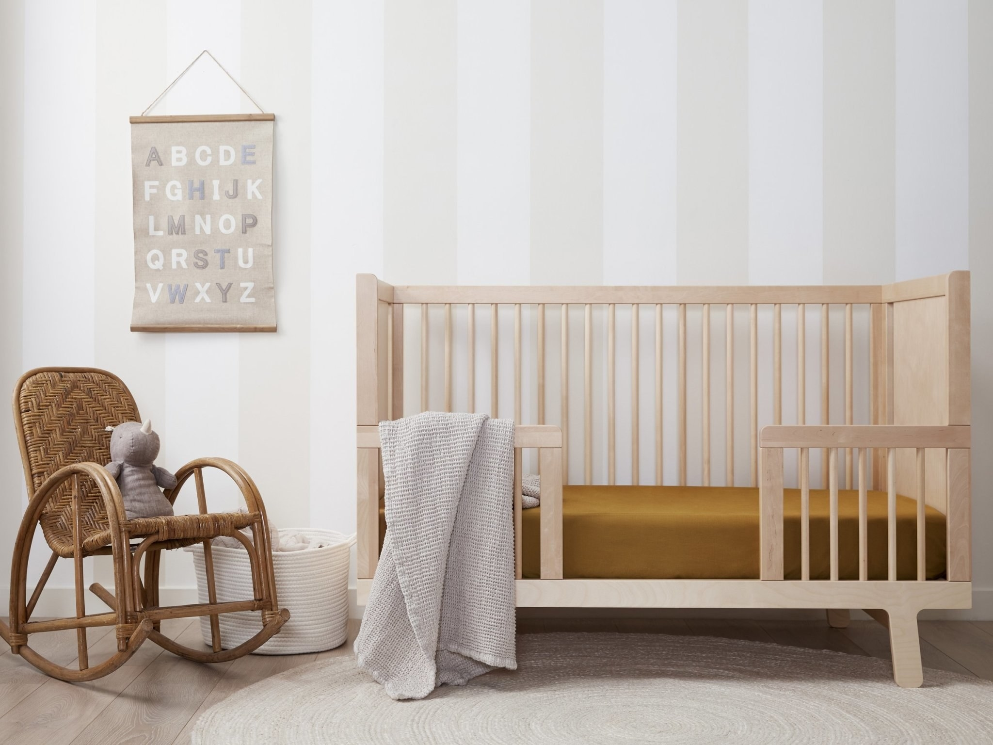 ochre colored sheets in a crib