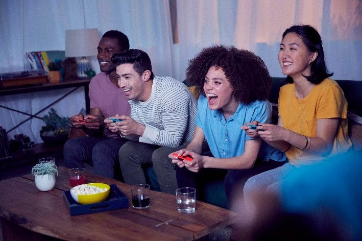 A group of friends playing a game together with their switches
