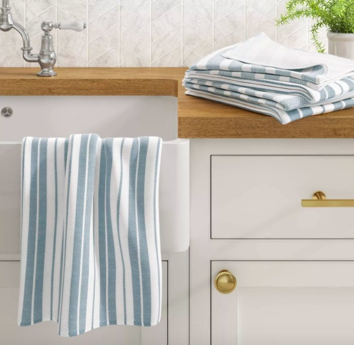 Striped blue and white kitchen towel draped over the sink.