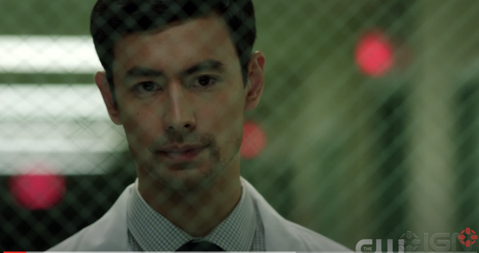 A shot of George Young through glass