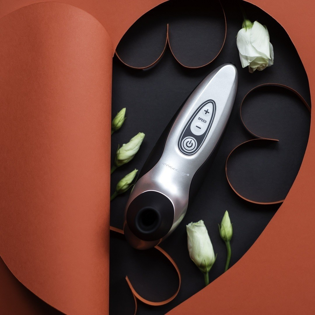 Black and silver suction vibrator inside cutout heart