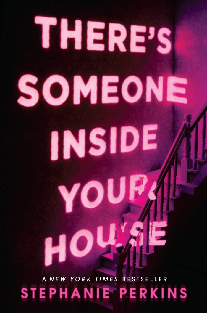 The cover art for There's Someone Inside Your House which has the title hovering over a stairwell