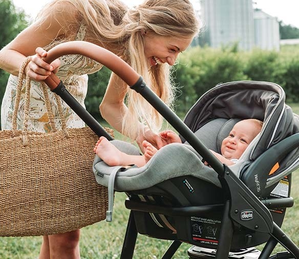 a baby in the car seat in a stroller