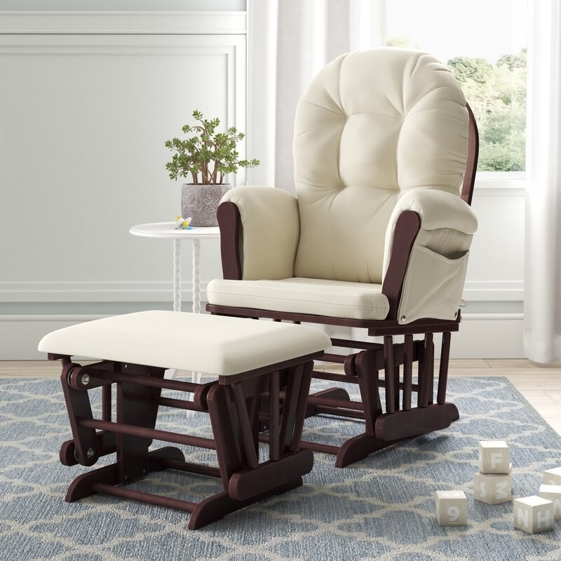a cream colored glider with a matching ottoman