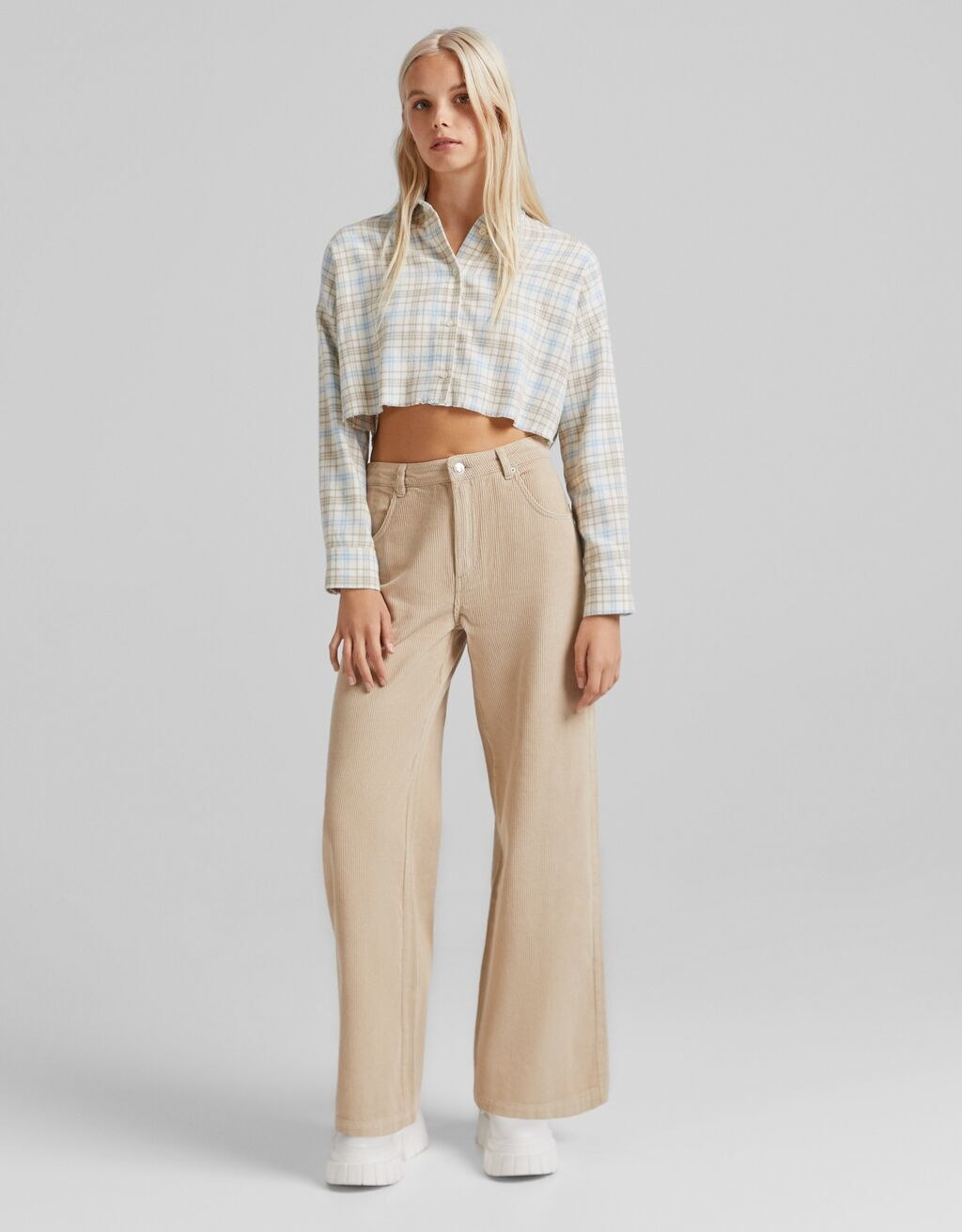model wearing the cream pants