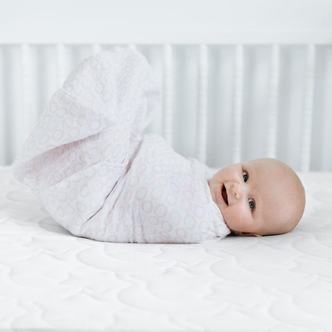 a baby in a halo swaddle