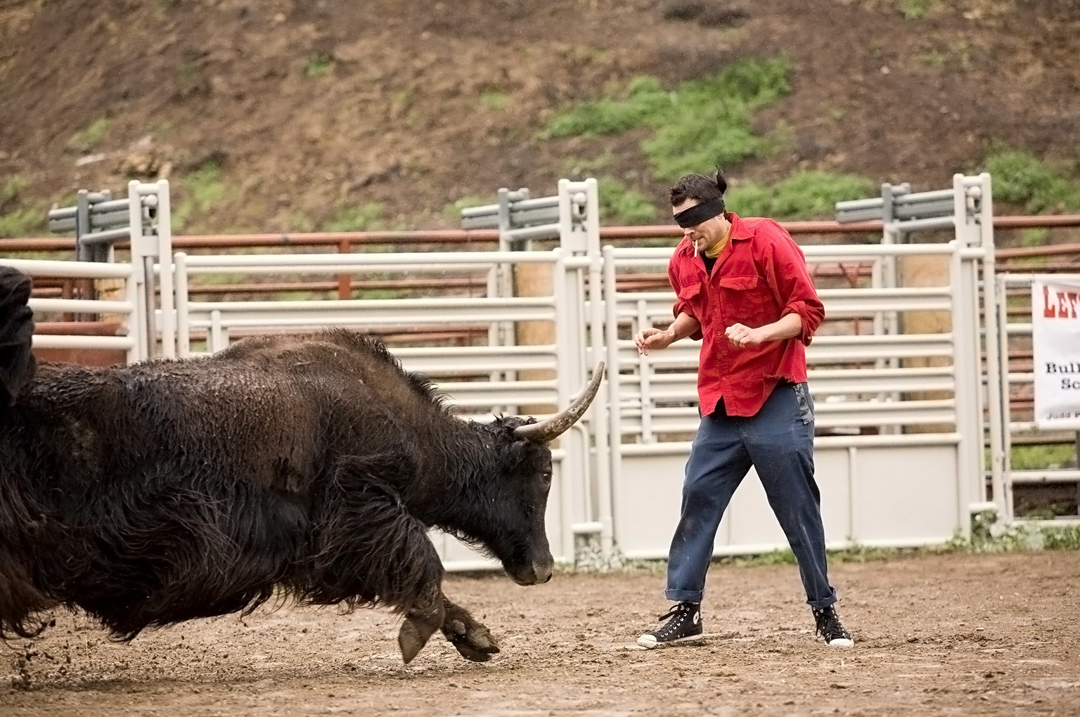 Knoxville braces himself before getting hit by a bull