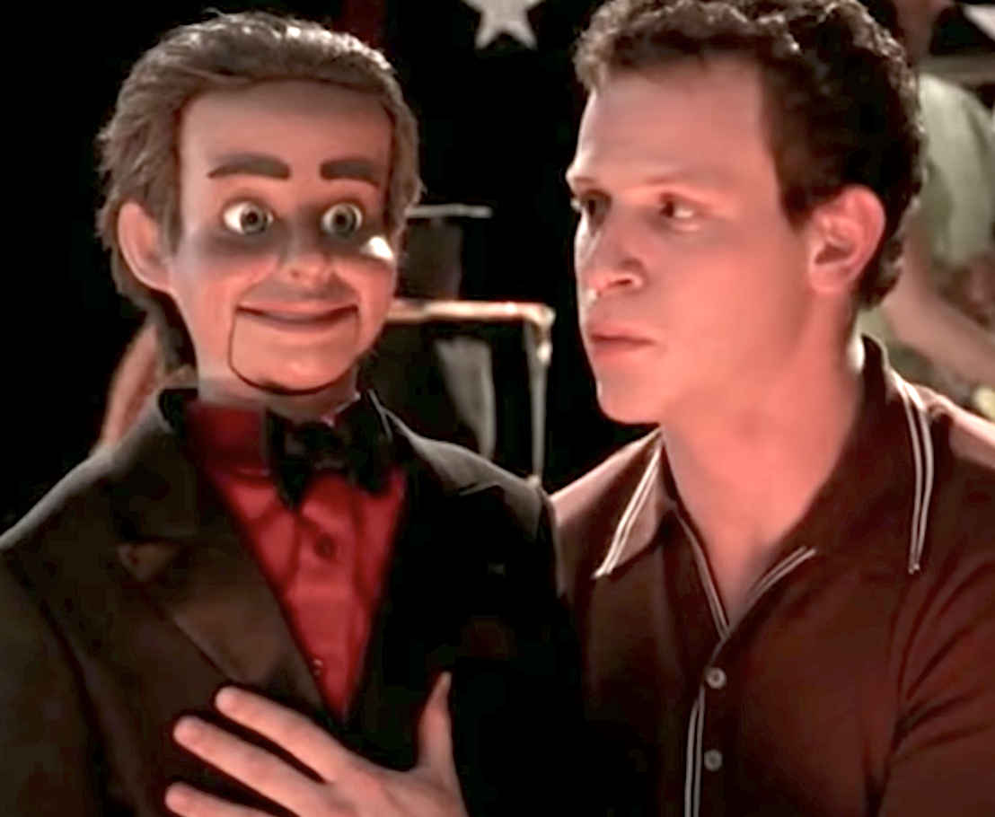 ventriloquist with dummy in suit