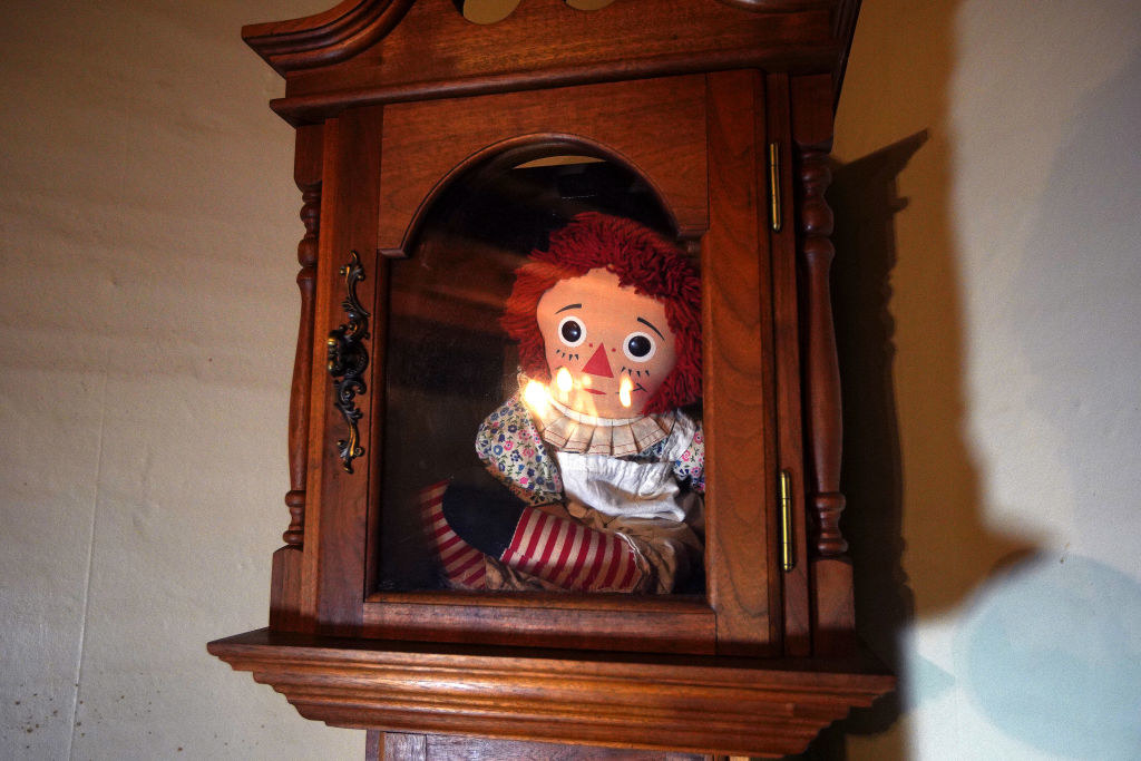 real Annabelle doll in a wooden and glass case