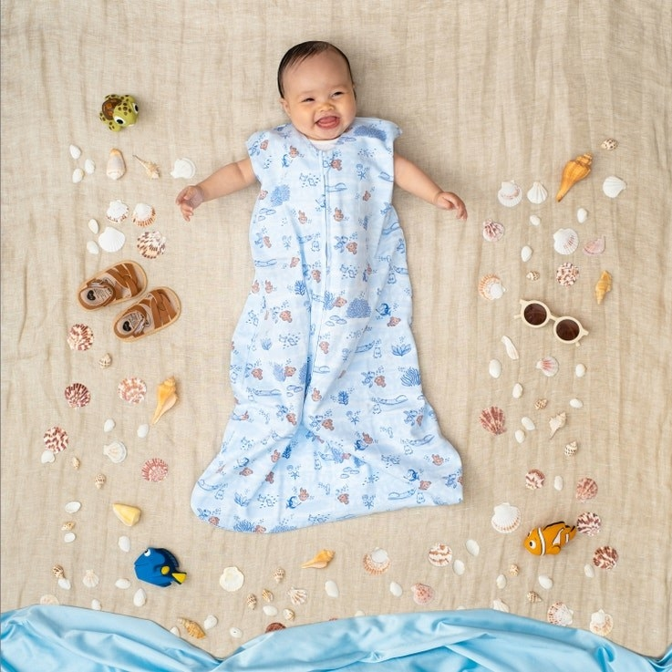 a baby in a finding nemo print sleep sack