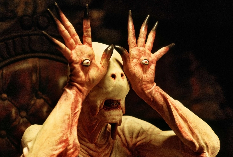 alien creature with eyeballs on its palms