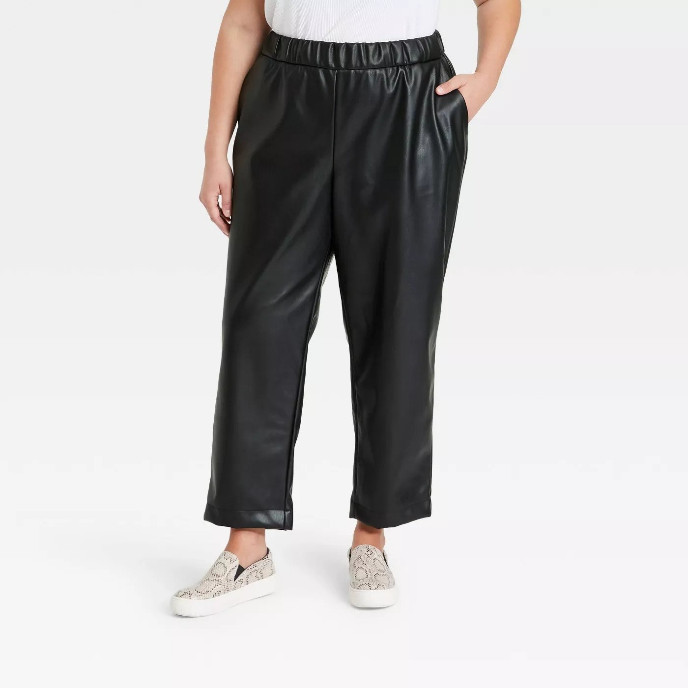 Model wearing black pleather pants, goes past the ankle