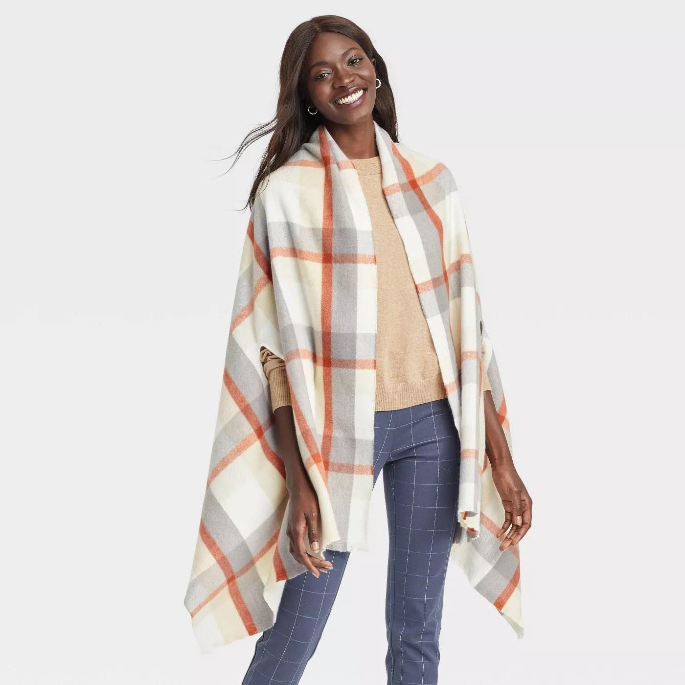 Model wearing gray, orange, and white striped open jacket